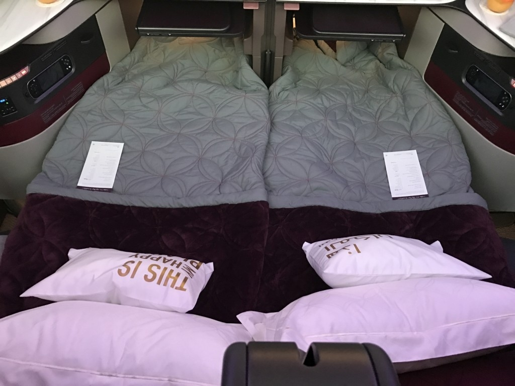 qatar airways new business class seat bed