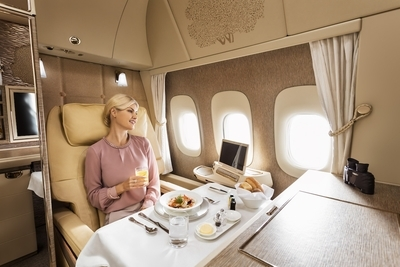 Book Emirates First Class Suite Boeing 777-300ER on miles