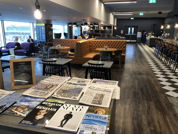 Lomond Lounge Glasgow Airport newspapers